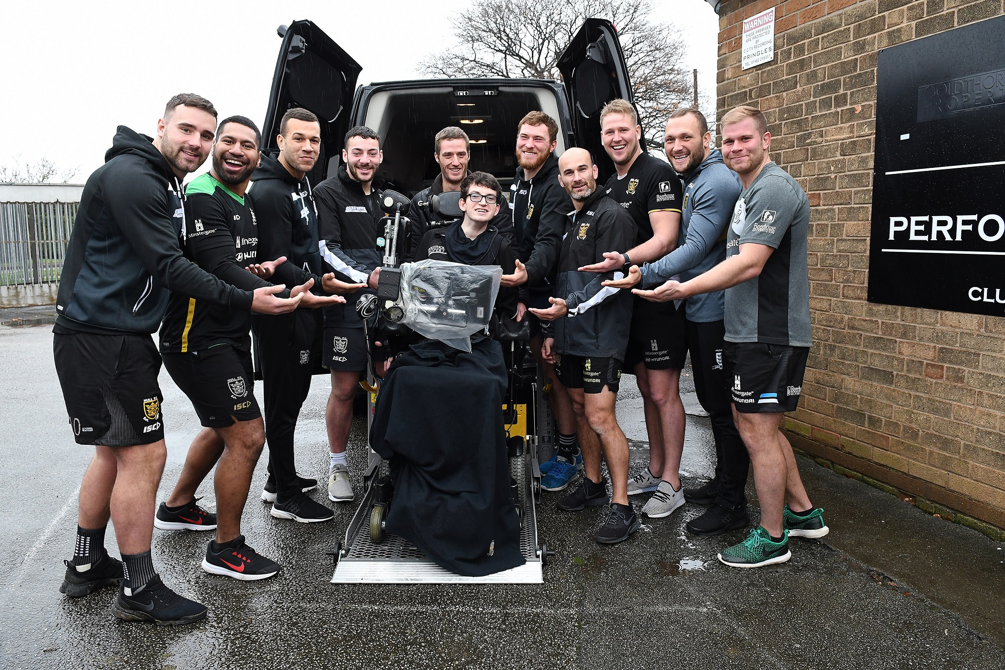 Hull FC players hand over new Ford Transit Custom WAV to Wes