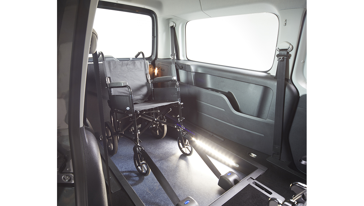 VW Caddy WAV with the seats tipped forward