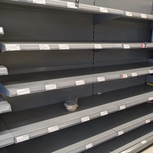 Empty shelving at a supermarket due to stockpilers in the pandemic